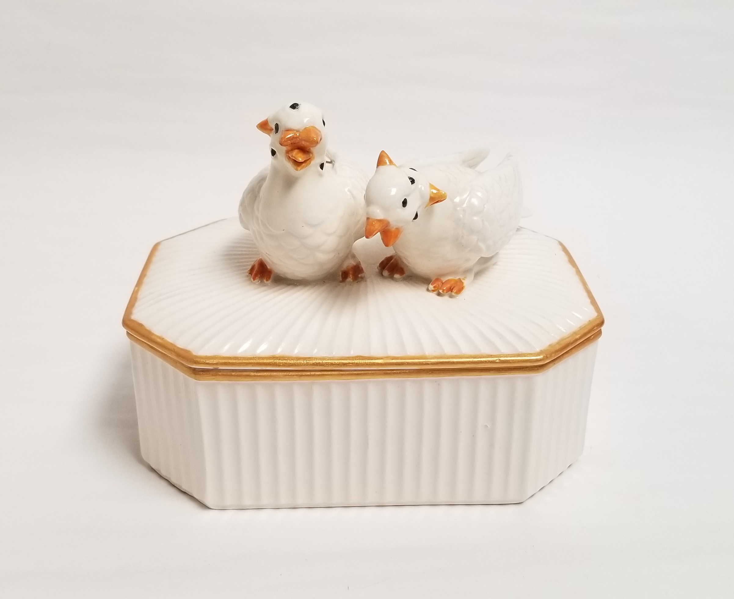 "Debra Broz, Many-faced Doves, 2021 Mixed media on secondhand ceramic figurines 4"" x 6"" x 4"""