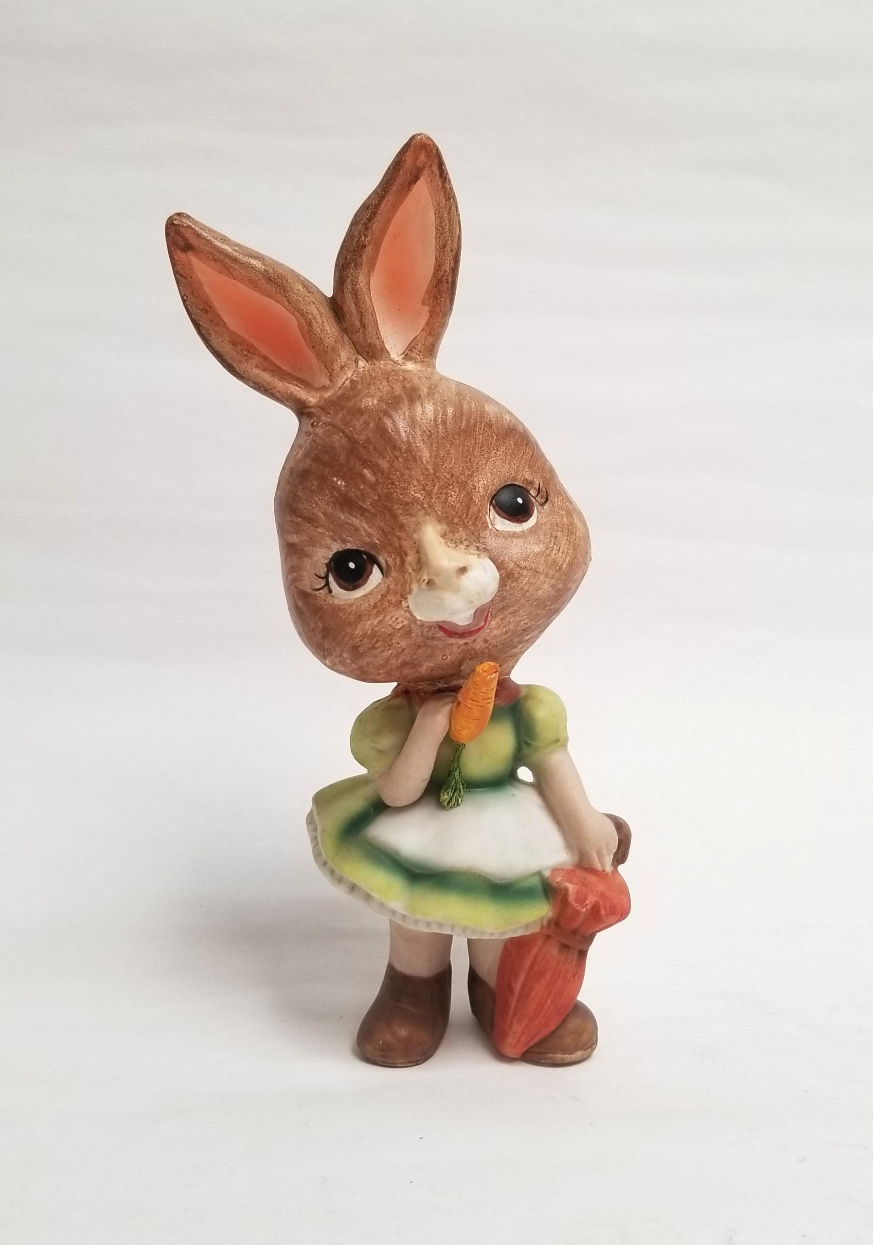 "Debra Broz, Rabbit Girl, 2021 Mixed media on secondhand ceramic figurines 6 ½"" x 3"" x 3"""