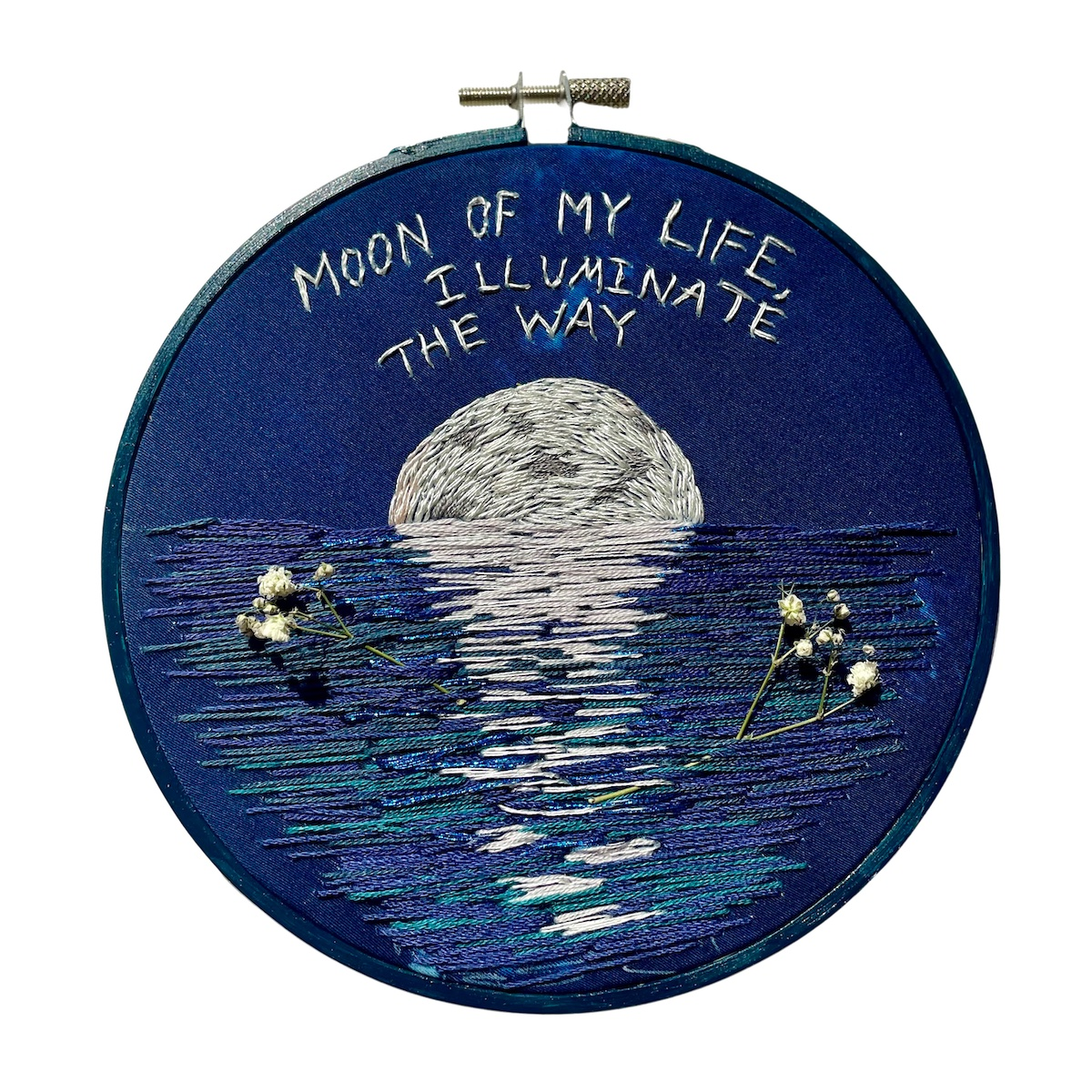 """Amber Mustafic Moon of My Life, 2021 Hand embroidered cyanotype on cotton with dried baby's breath flowers 8"""" diameter"""